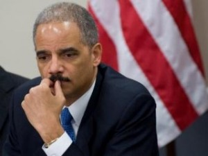 eric holder mentions that he and obama are african american