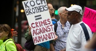 koch brothers protest sign