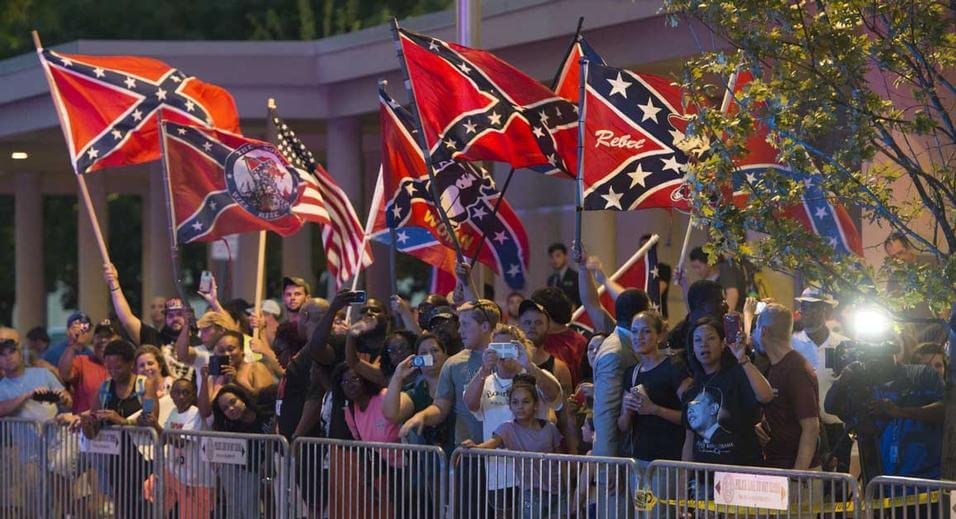 By black man waving confederate flag in oklahoma your black world
