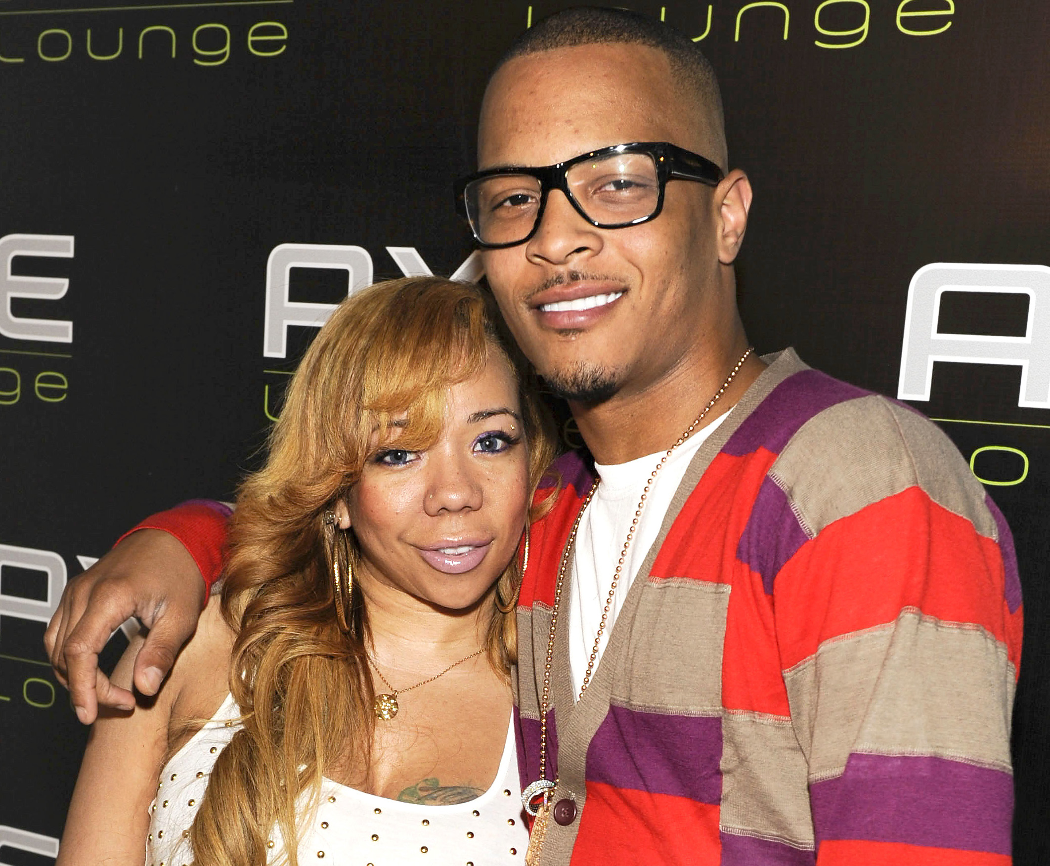 """SOUTHAMPTON, NY - AUGUST 13:  Tameka 'Tiny' Cottle and T.I visited the AXE Lounge in Southampton on Friday to announce that he is performing a secret show to kick off the """"AXE Music One Night Only"""" concert series in Manhattan on Monday night on August 13, 2010 in Southampton, New York.  (Photo by Eugene Gologursky/Getty Images for AXE) *** Local Caption *** Tameka 'Tiny' Cottle;T.I"""