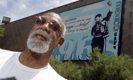 John Carlos, participant of the 1968 Olympics, stands in front of a mural made by students on the campus, at Palm Springs High School, where he is a teacher and counsellor in Palm Springs, California July 11, 2012. Picture taken July 11, 2012. REUTERS/Alex Gallardo (UNITED STATES - Tags: SPORT OLYMPICS HEADSHOT)